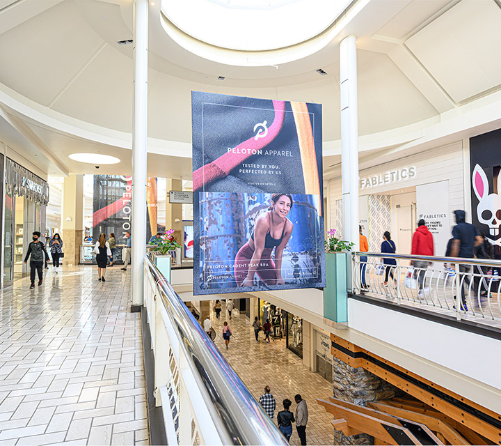 Peloton taking advantage of a Macerich Media Network opportunity with a large-format banner