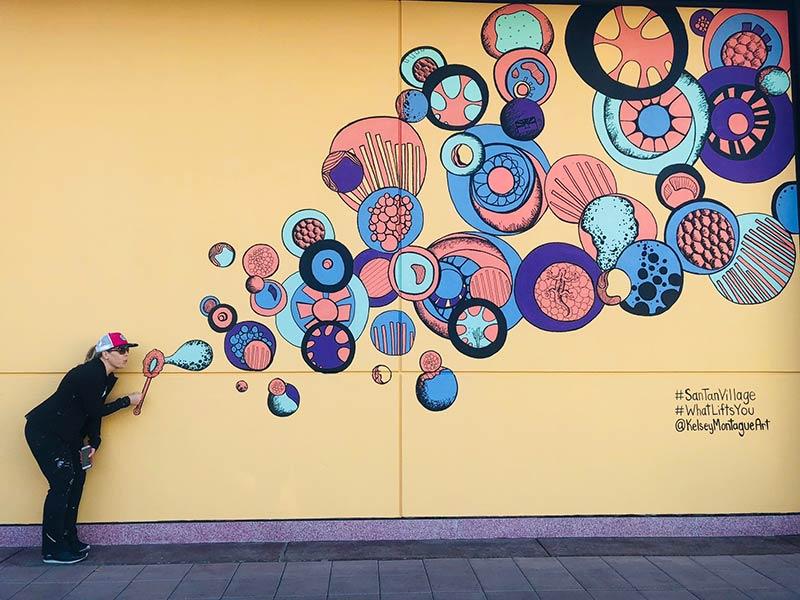 Kelsey Montague mural of blowing bubbles at SanTan Village