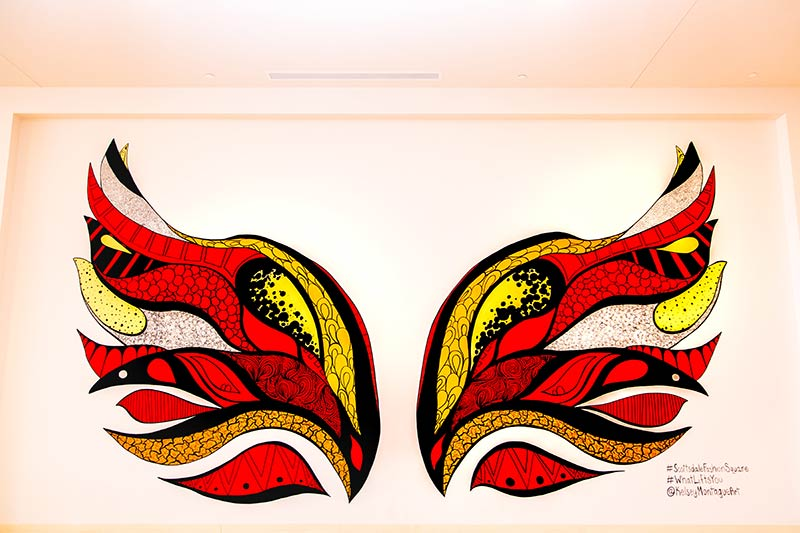 Kelsey Montague mural of red, yellow, and orange wings at Scottsdale Fashion Square