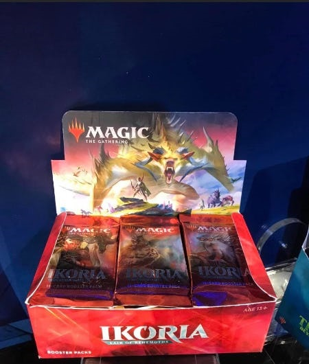 IKORA trading cards in red box with dragon background