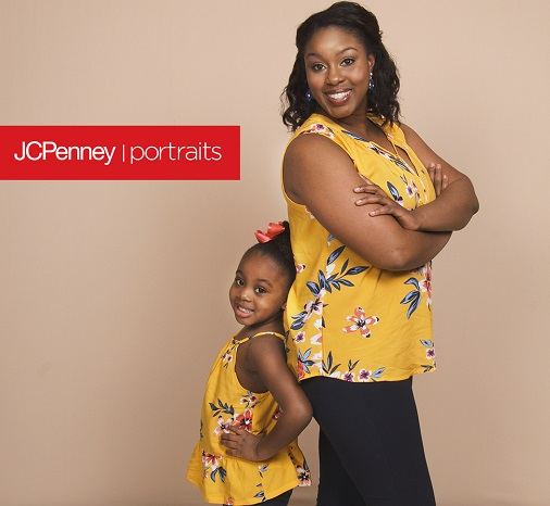 Woman with little girl both dressed in yellow tops and black pants