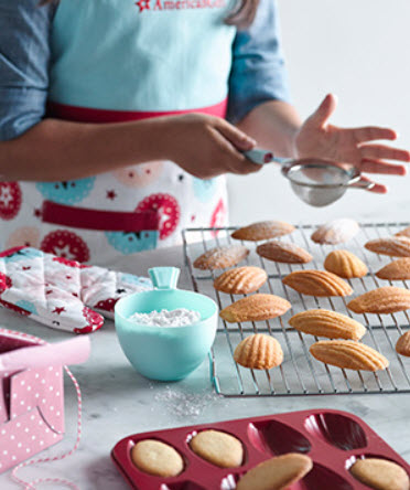 Girl making madeleines