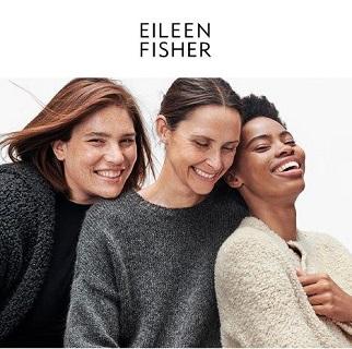 Three women in sweaters.