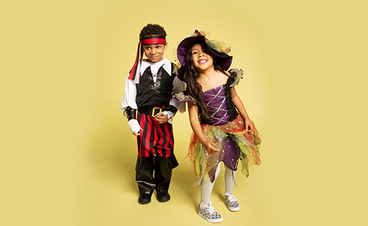Two young children dressed in costumes.