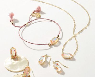 Kendra Scott jewelry, including bracelet, necklace, earrings and ring.