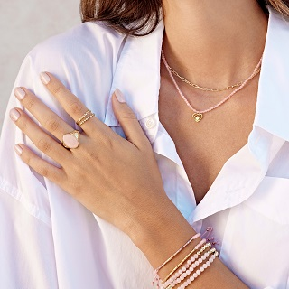 Woman wearing gorjana Rose Quartz jewelry collection.