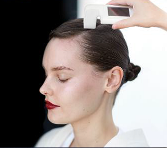 Women receiving scalp treatment.