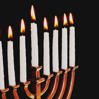 Menorah with eight candles lit.