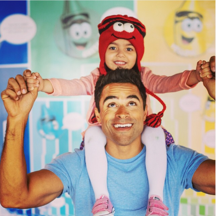 dad and kid with crayon hat