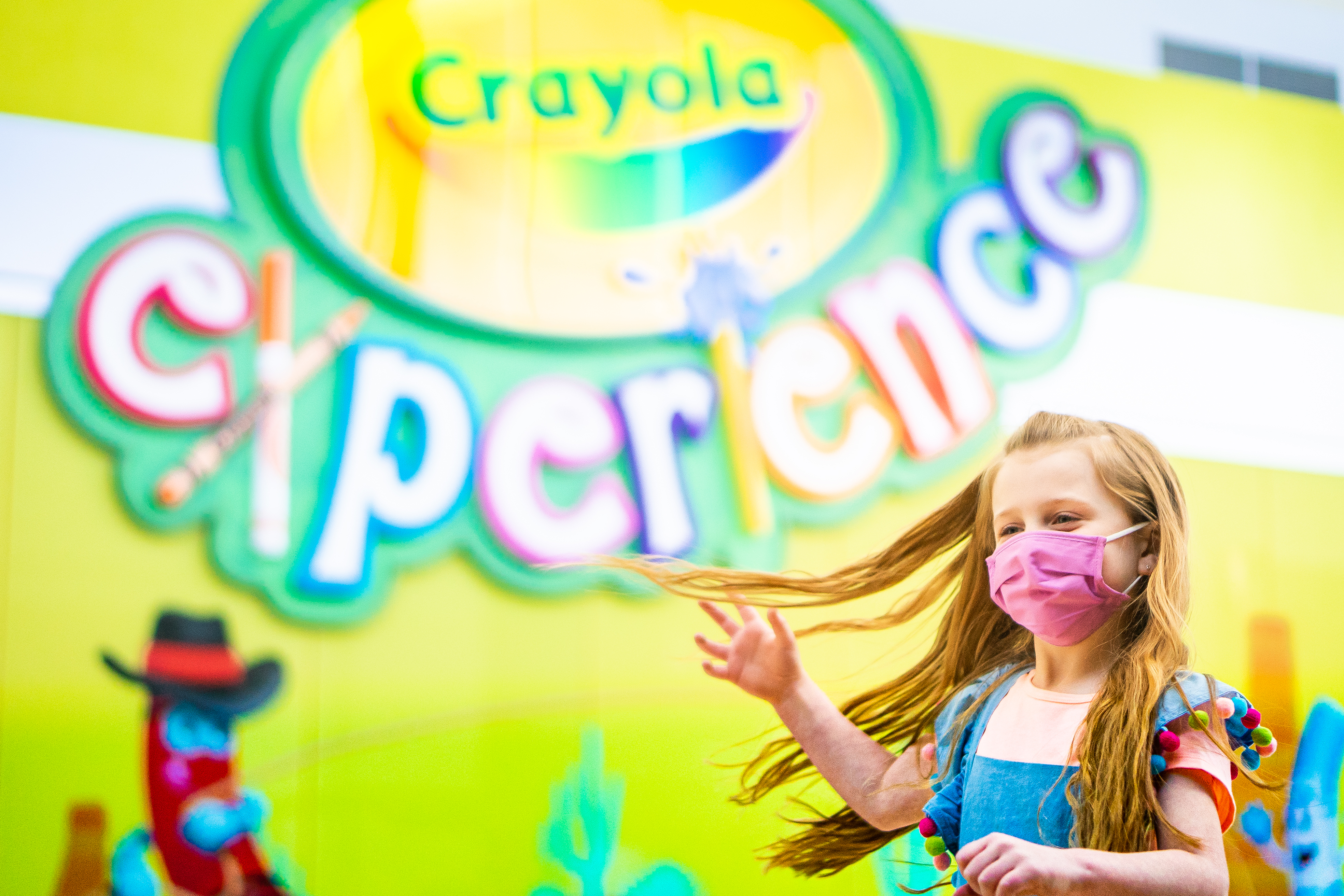 Young girl in front of Crayola Experience store