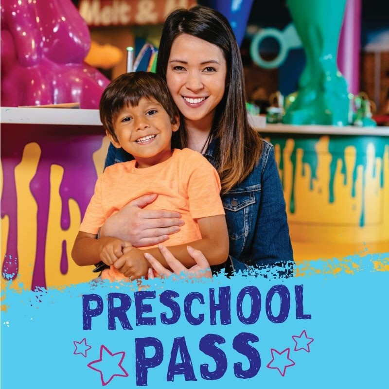 Woman holding child behind light blue footer which reads preschool pass in dark blue