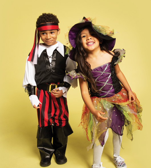 Children dressed as a pirate and witch.