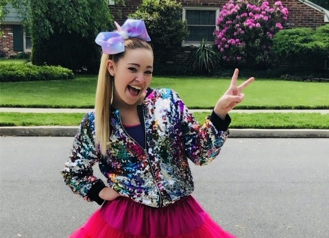 Blonde teen with big bow in her hair
