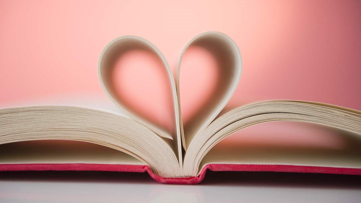 pages of a book in a heart shape