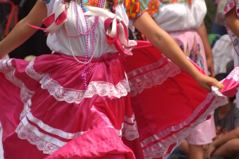 woman in traditional Mexican apparel dancing