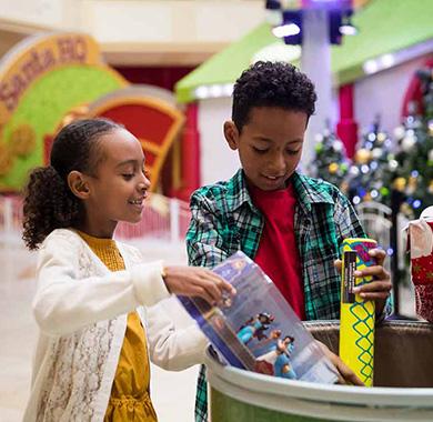 Children donating toys