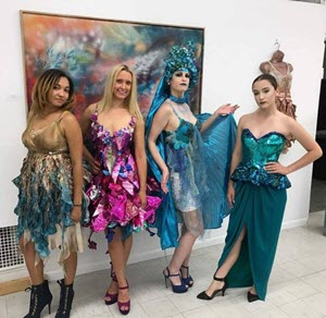 Models wearing upcycled fashions