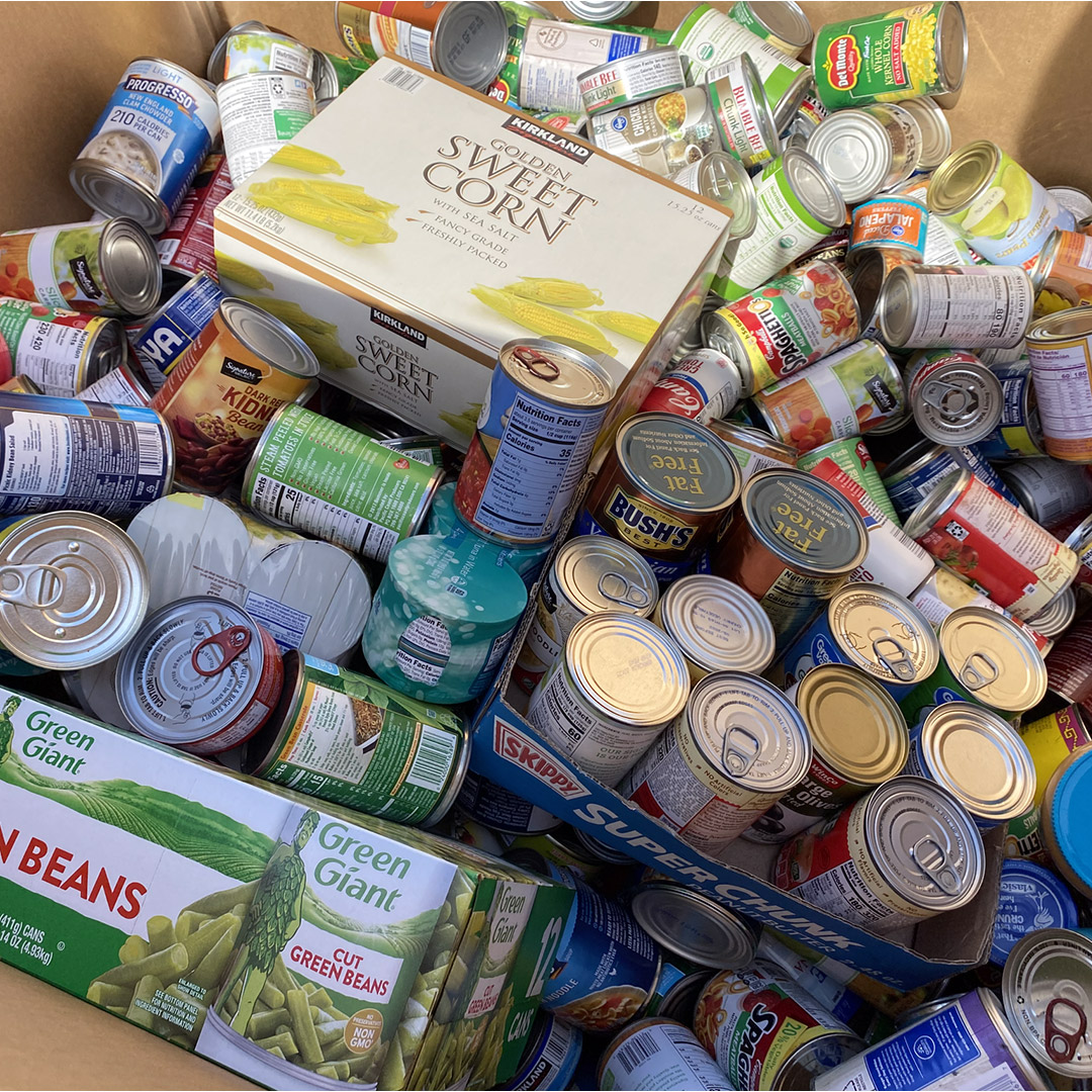Various donated food items in a box