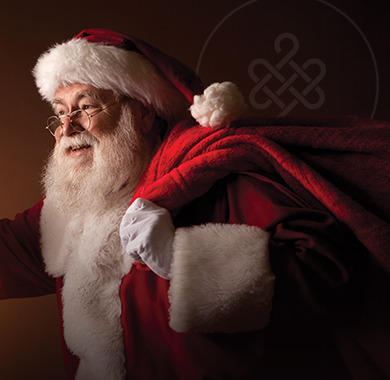 Happy Santa in front of a red background