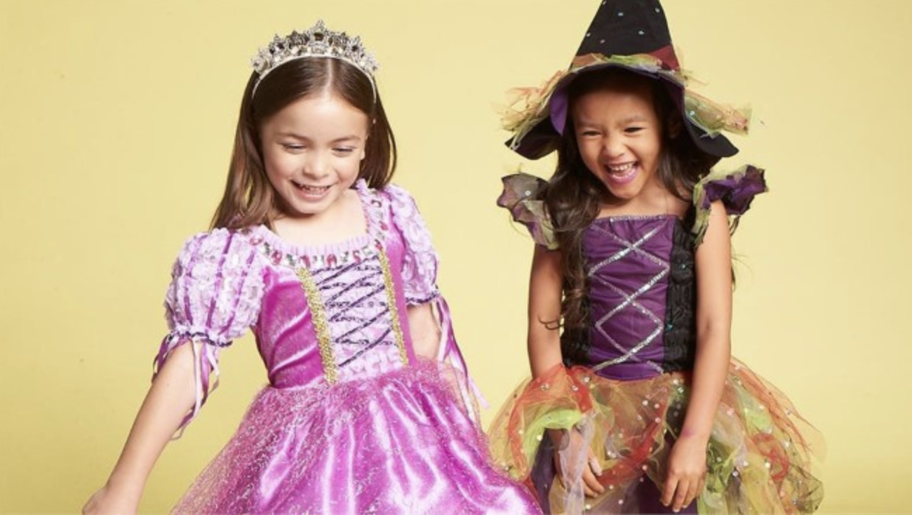 Two young girls in Halloween costumes.