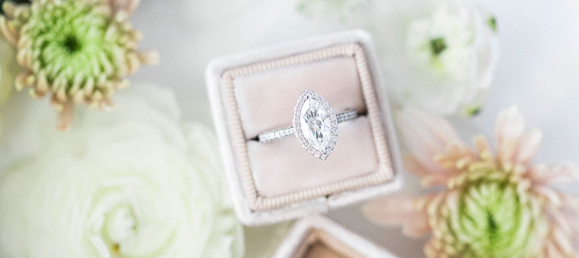 diamond ring with surrounding flowers.