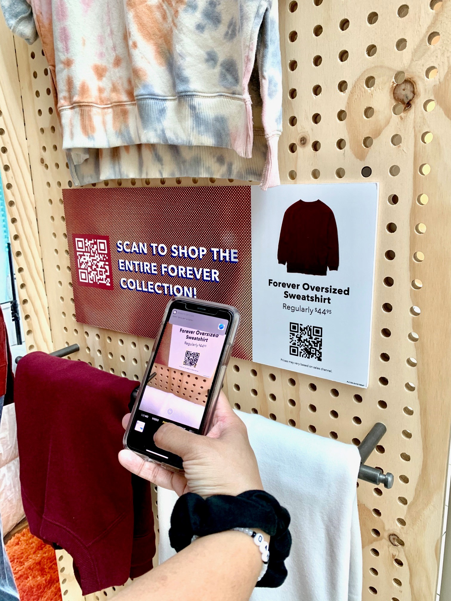 Scanning QR Code from Mobile Display.  Wording says: Scan to shop the entire forever collection.  Forever Oversized Sweatshirt Regularly $44.95