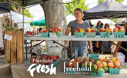 "woman selling peaches at a Farmers Market.  Wording on photo says: ""Freehold Fresh"" and ""Freehold Raceway Mall""."