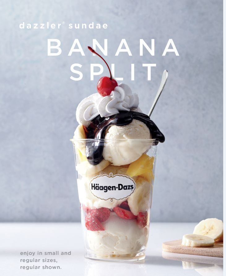 Banana split ice cream cut with fruit and whipped cream.