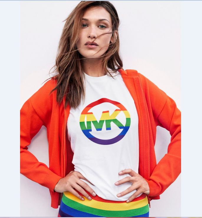 Young lady wearing Michael Kors pride T Shirt