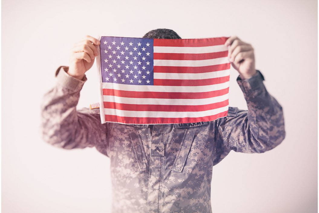 Solider Holding American Flag