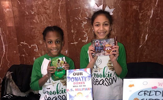 Little Girls Selling Girl Scouts Cookies