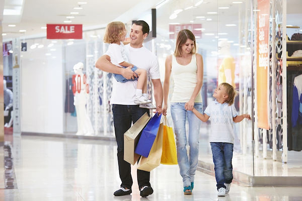 family of four walking thru the mall and smiling
