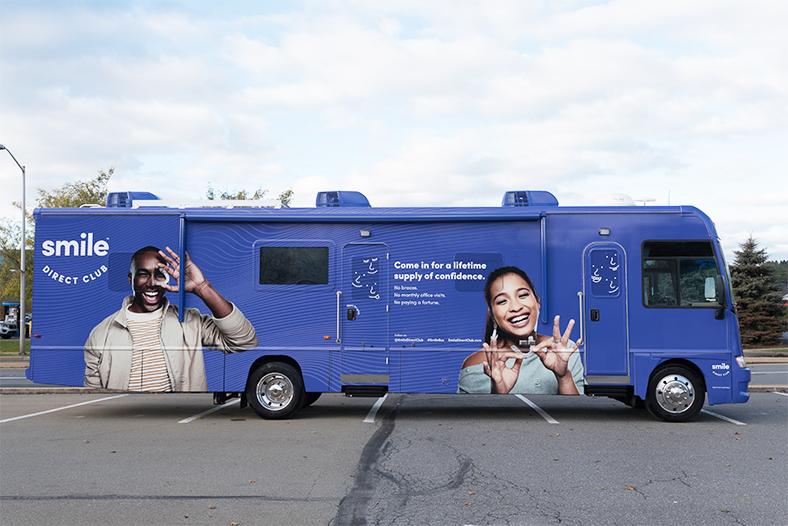 Smile direct branded blue mobile van