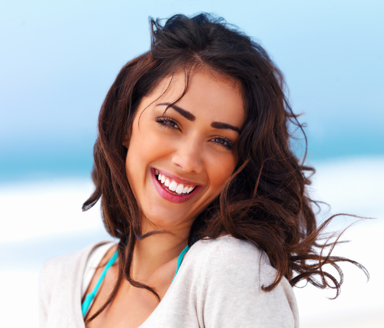 image of attractive women smiling in beach wear.