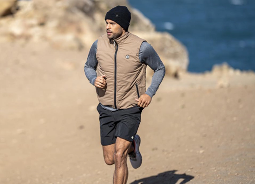 Man running outdoors wearing athletic clothing.