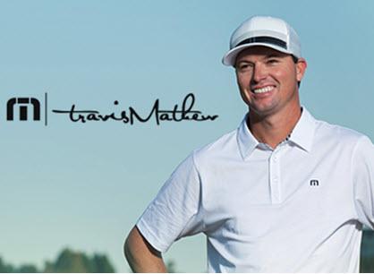 Man smiling wearing golf attire.