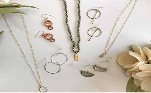 Flat lay of jewelry items including necklaces and earrings