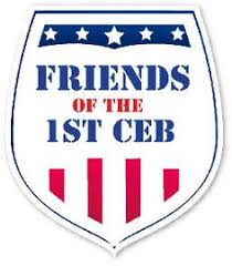Badge Logo with blue/white stars across the top, Typed words Friends of the 1st CEB and Red/white bars across the bottom.