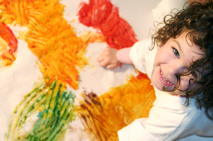a girl finger painting