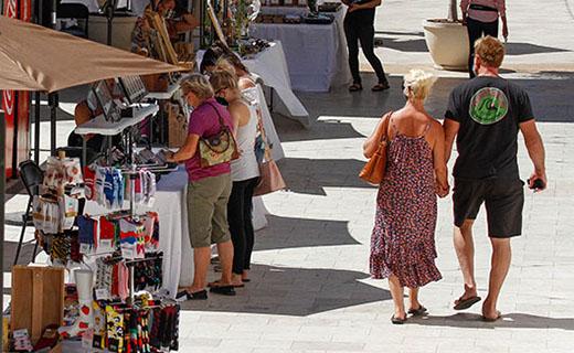 Couple walking through So Cal Etsy Guild vendors at The Oaks