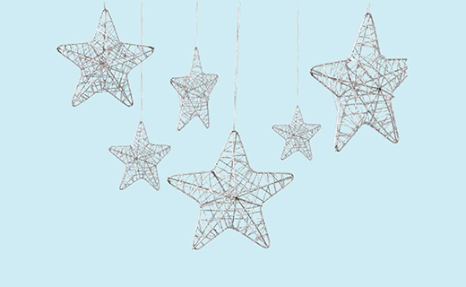 hanging star ornaments on blue background