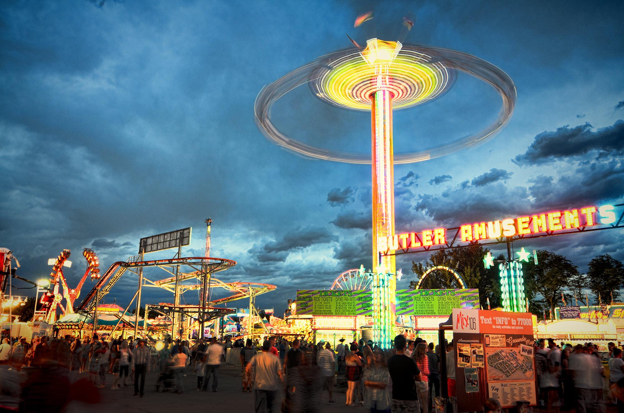 carnival scene including a ferris wheel