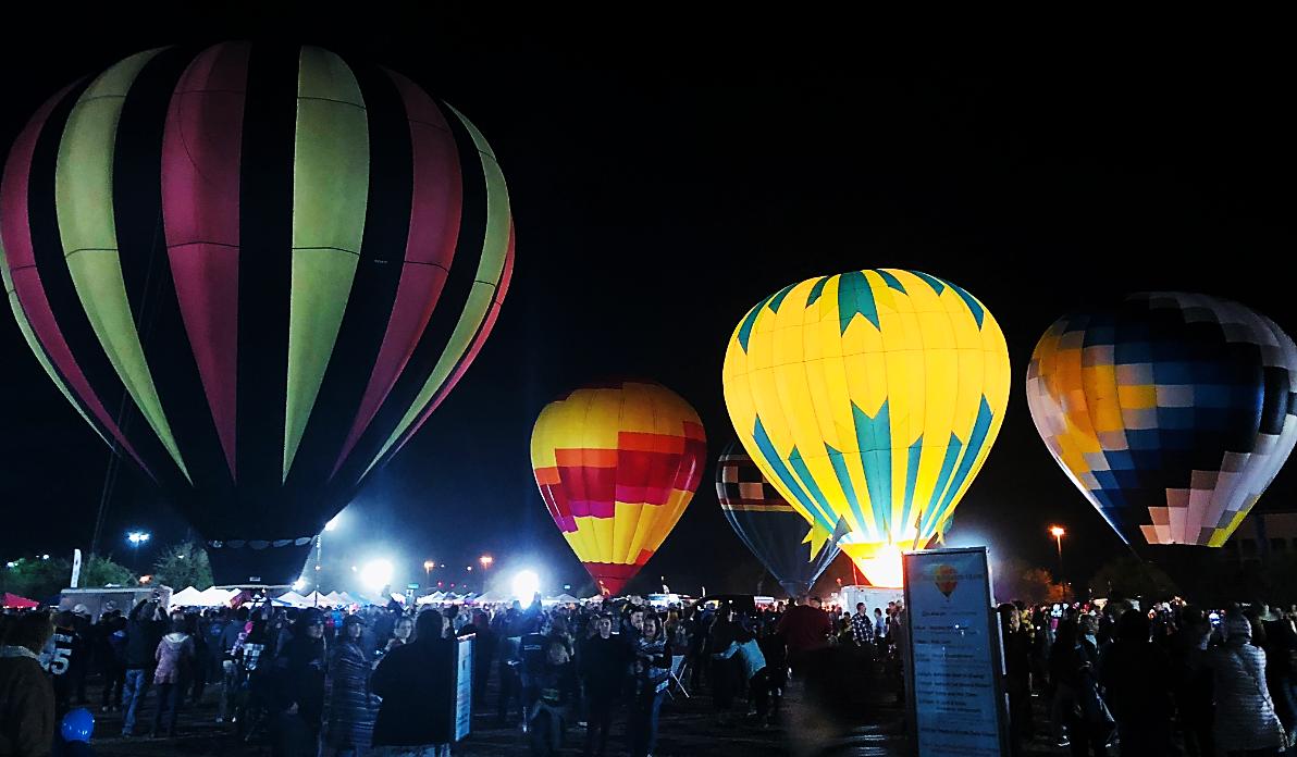 Five hot air balloons at night time
