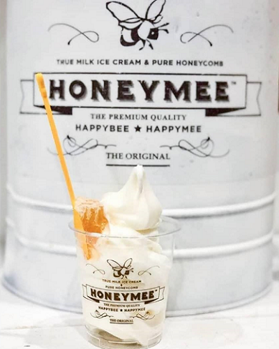 Honeymee milk container with ice cream in a cup.