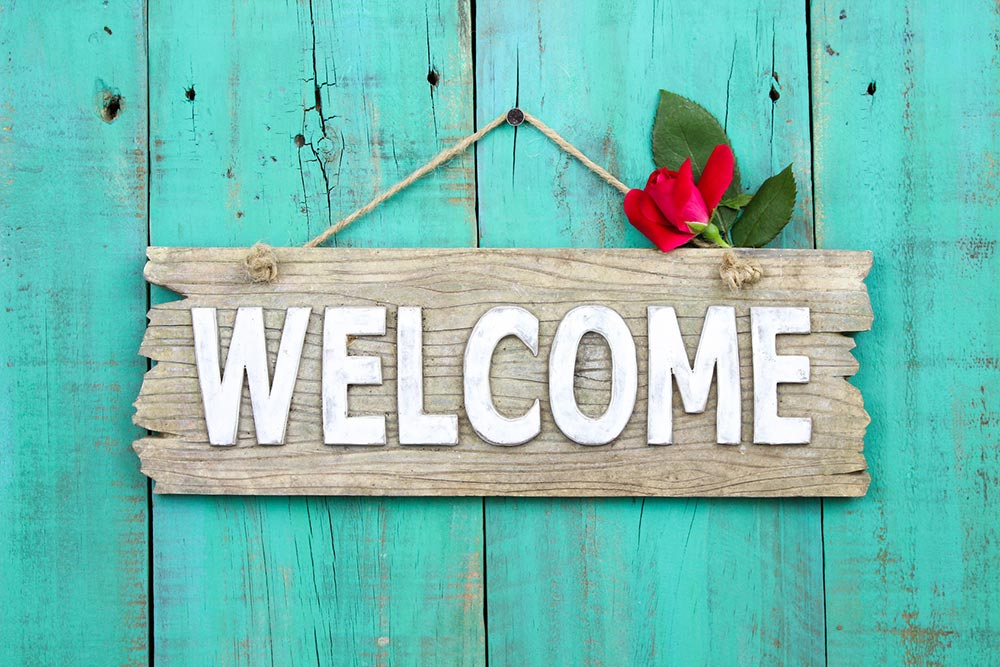 "Wood sign with copy ""welcome"""