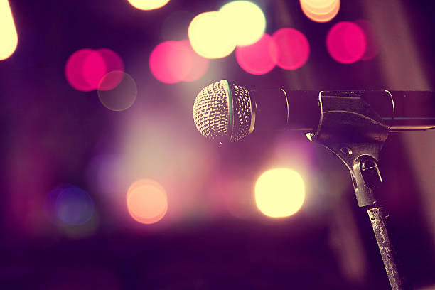 microphone on stand on lit stage