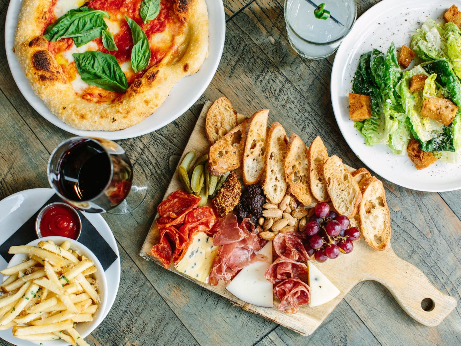 charcuterie board, truffle fries, pizza and salad