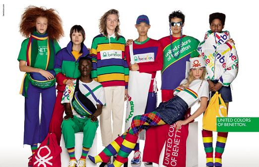 10 models posing in multicolored green, blue, red, yellow and white Benetton apparel