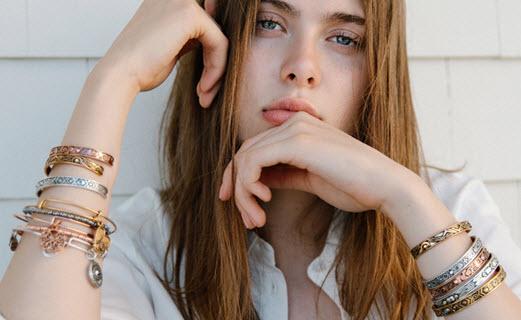 Girl wearing Alex and Ani bracelets