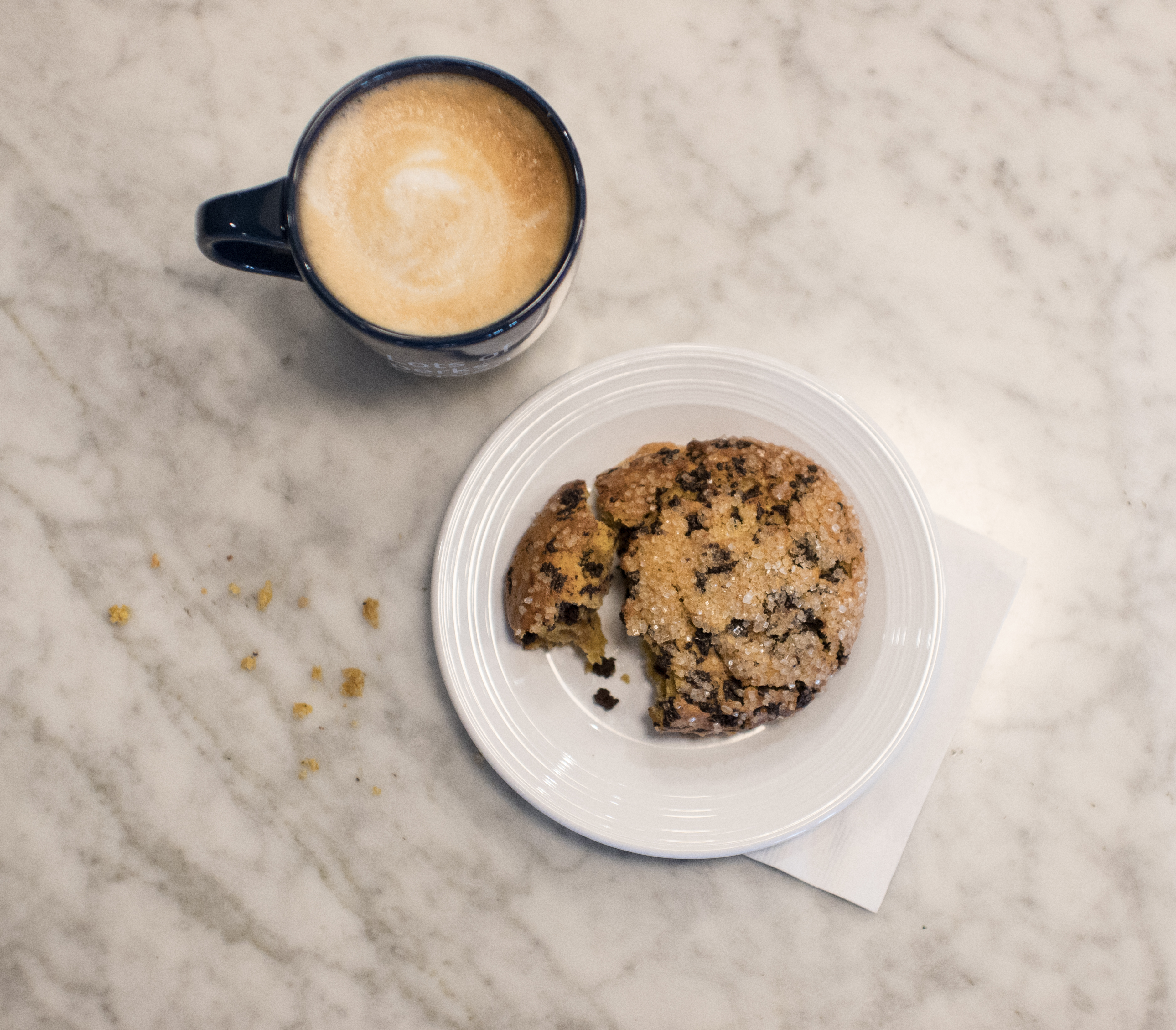 cup of coffee with a chocolate chip cookie